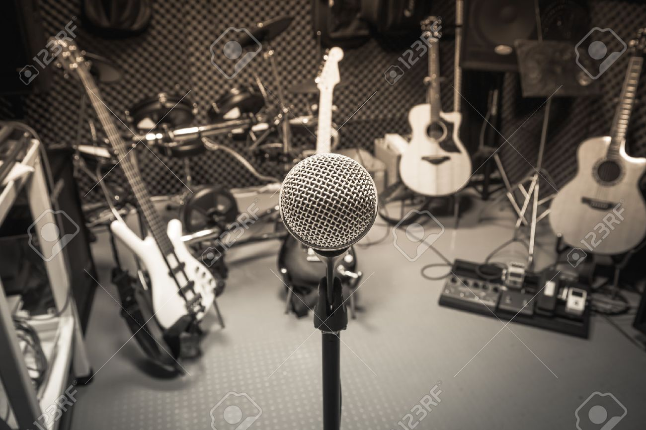 selective focus microphone and blur musical equipment guitar ,lyric, drum piano background. - 58042784