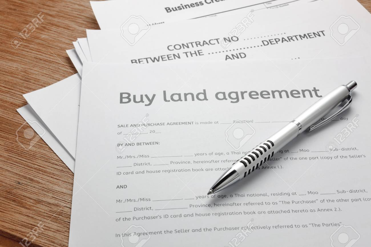 Pen And Land Contract Form On Wood Background.Bussiness Buy And ...
