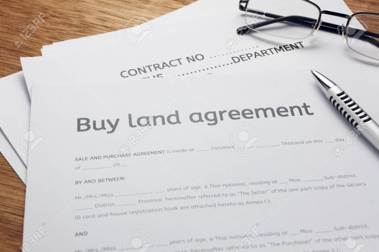 Pen,eyeglasses And Land Contract Form On Wood Background.Bussiness ...