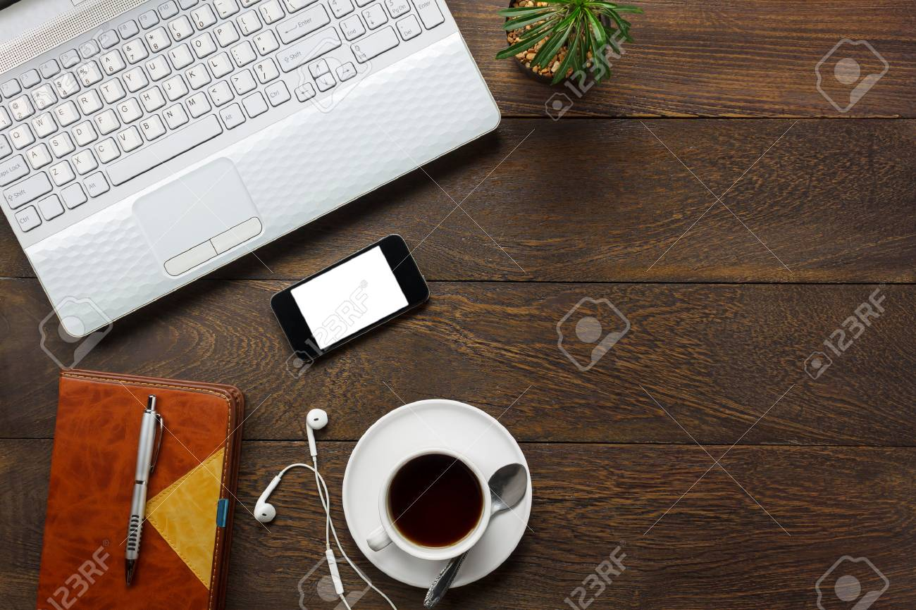 Stock Photo   Top View Accessories Office Desk The Mobile Phone,note  Paper,pencil,coffee,cactus On Wooden Office Desk Background.