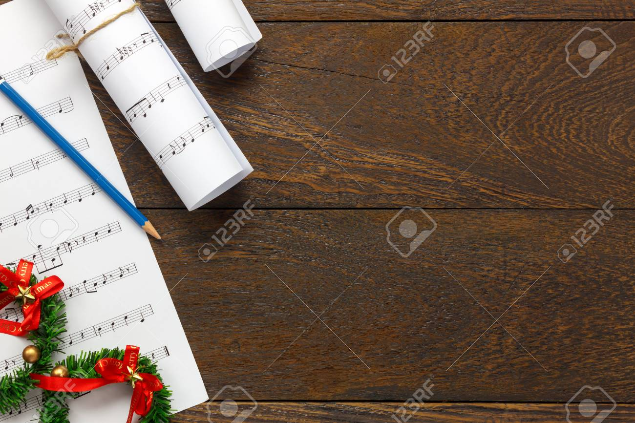 Top View Christmas Music Note Paper With Christmas Decoration