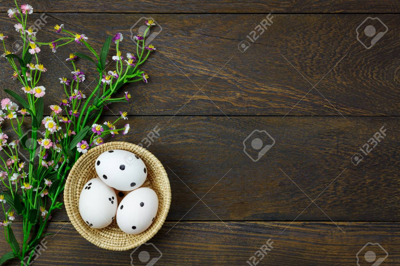 71822360 Top View Easter Background Happy Eggs Pained On Wood Basket Also Beautiful Flower Texture Rus