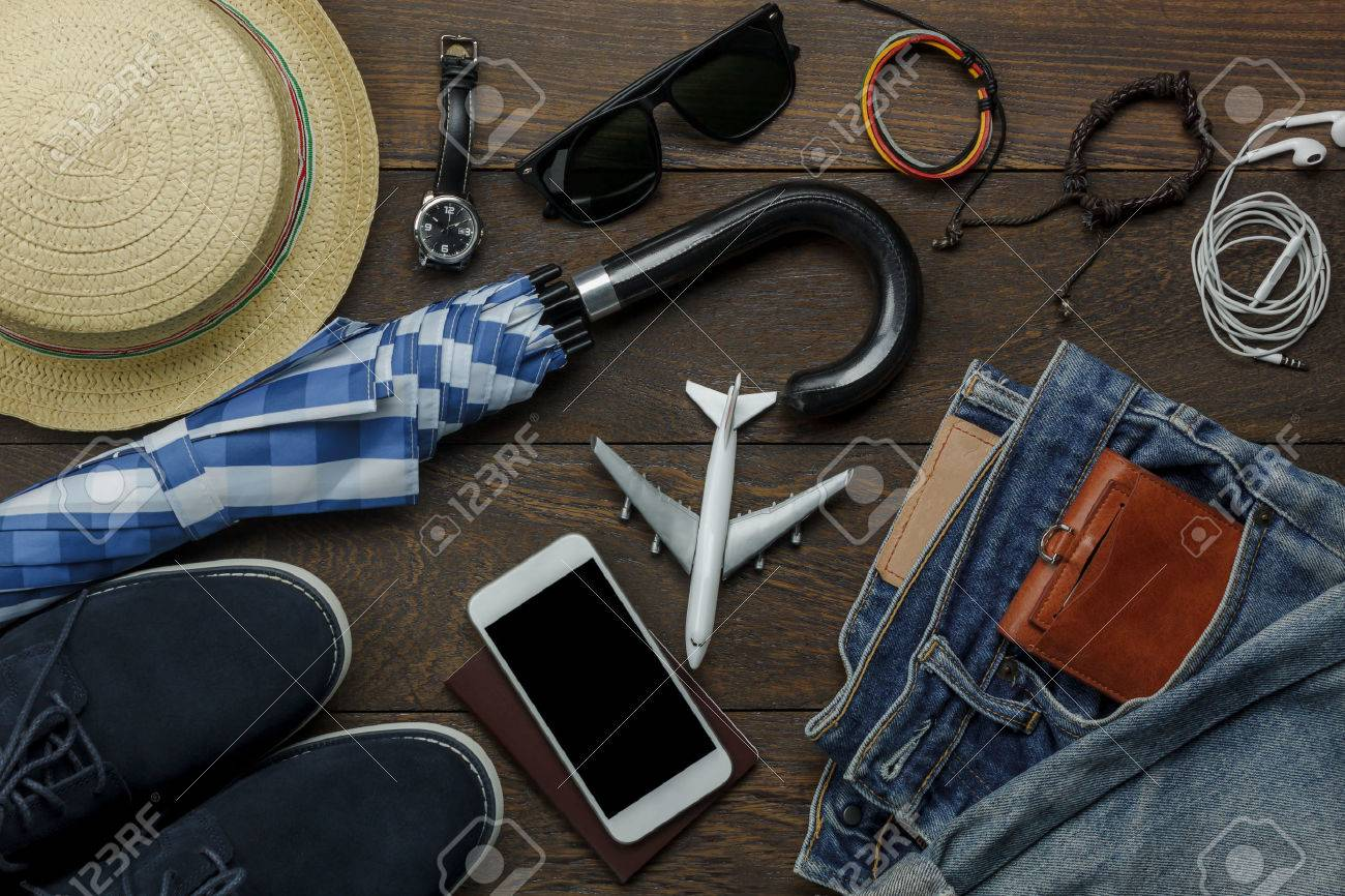 Overhead view of accessories fashion men clothing with technology concept background.Mix variety object on modern rustic wooden office desk.Essential items for teenage or adult and traveler to trip. Stock Photo - 86250178