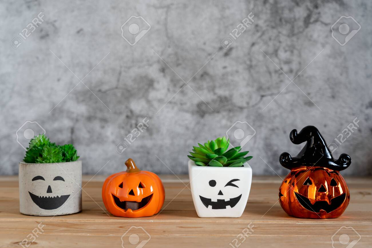 Accessories of decorations Happy Halloween day background concept.Jack O Lanterns cactus with spooky pumpkins object to party season with spider on modern rustic brown & white stone backdrop. - 131765142