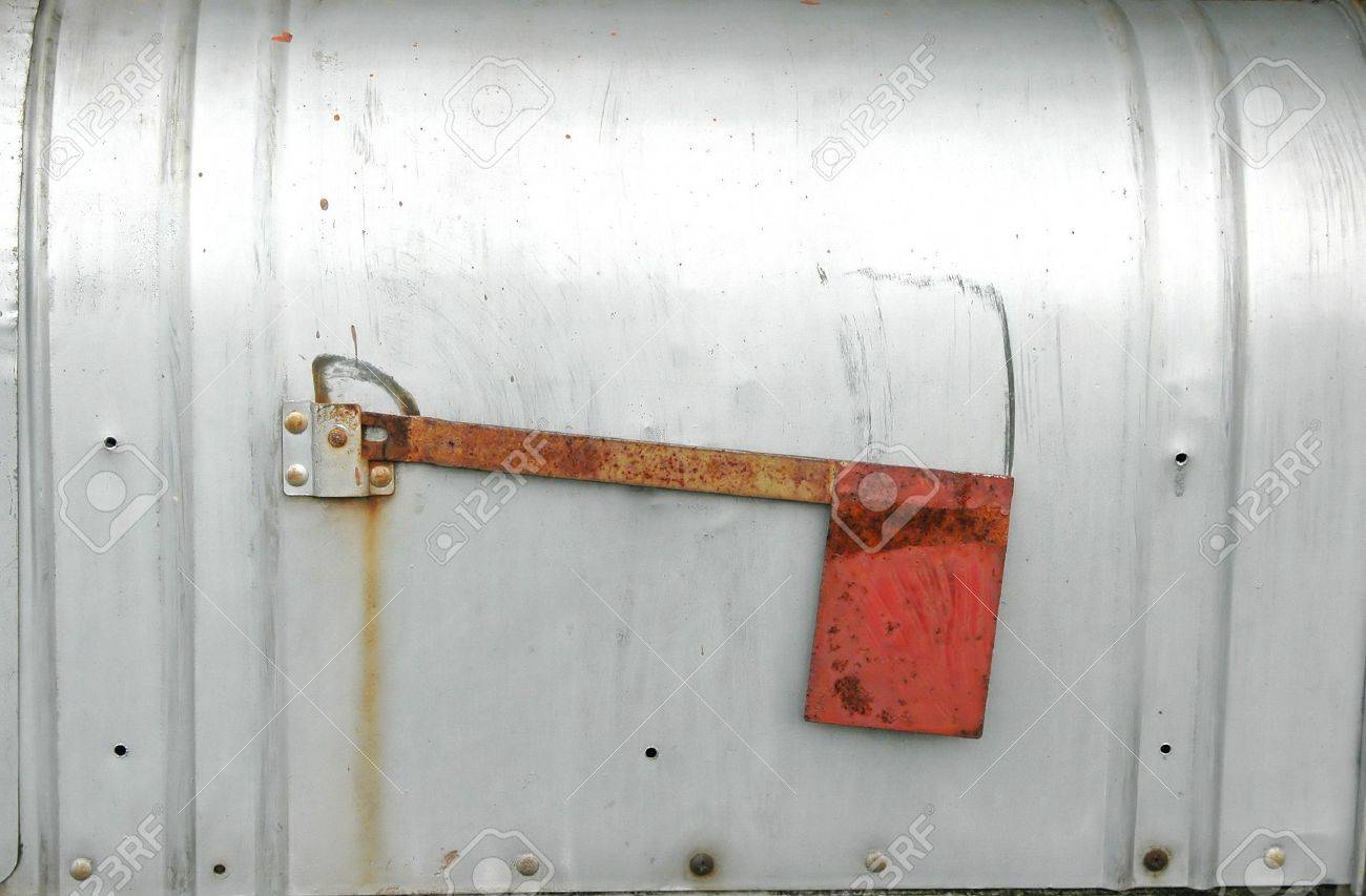 metal mailbox flag. Metal Mailbox With A Red Flag Stock Photo - 876712