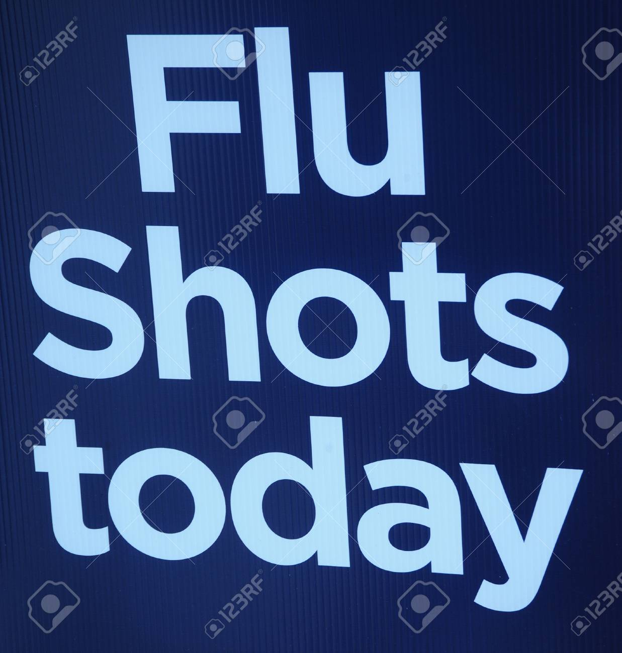 Flu shots today sign on display outdoors. Stock Photo - 8632730