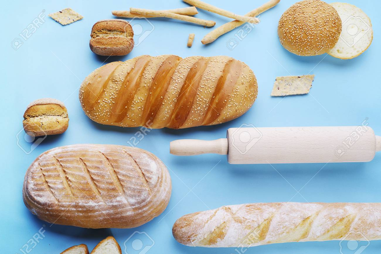 Decorative display of wheat baking and kitchen accessories on decorative display of wheat baking and kitchen accessories on a light blue background top view workwithnaturefo