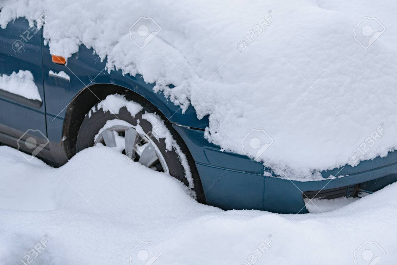 Close up on car standing in the parking lot covered with a thick layer of snow. - 146516660