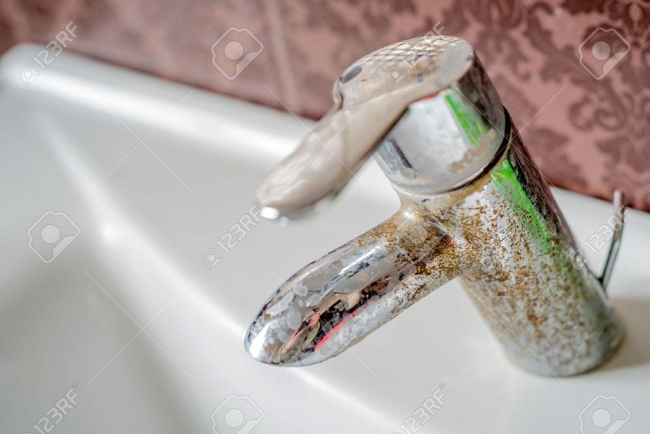 Hard water calcium deposit on chrome tap - 68628623