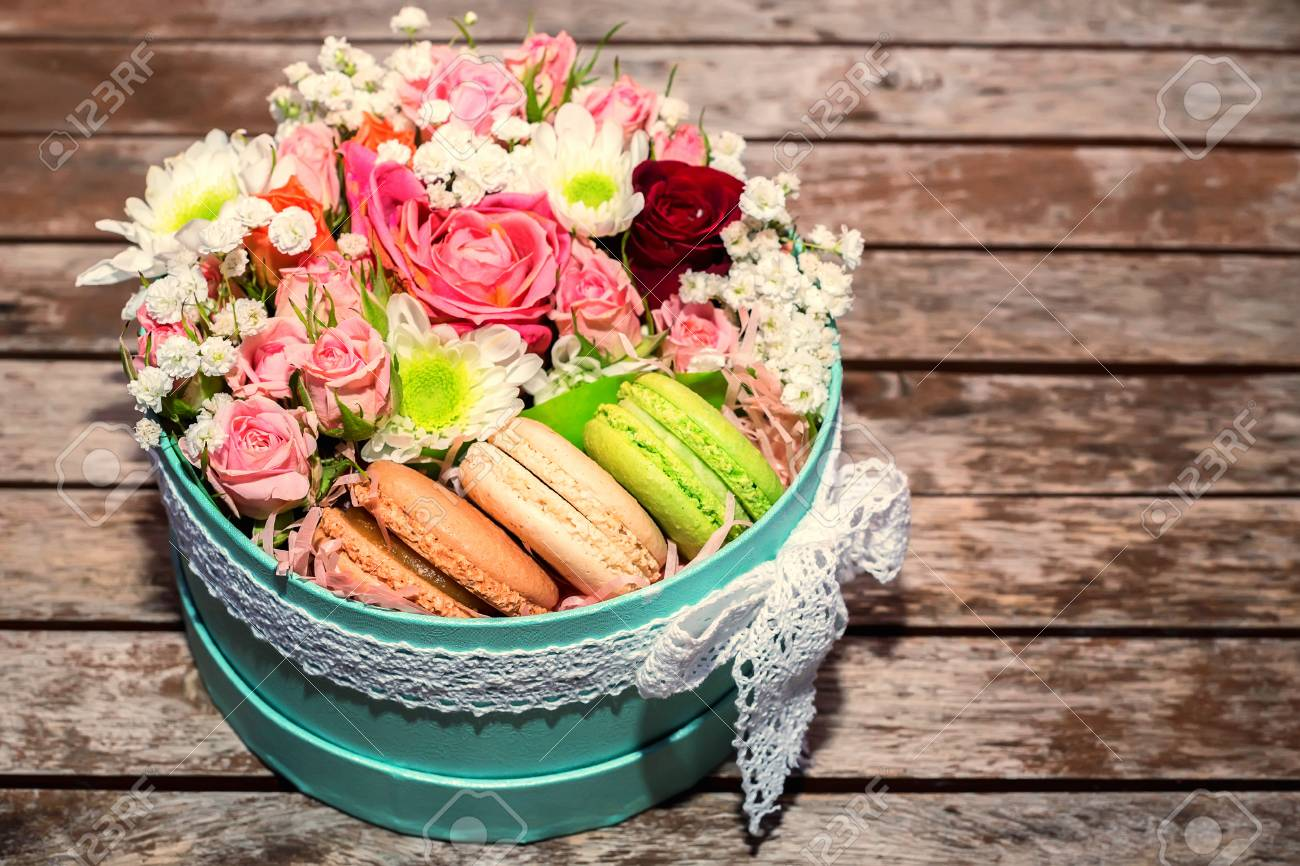 Love gift with flowers and macarons stock photo picture and royalty love gift with flowers and macarons stock photo 77738544 negle