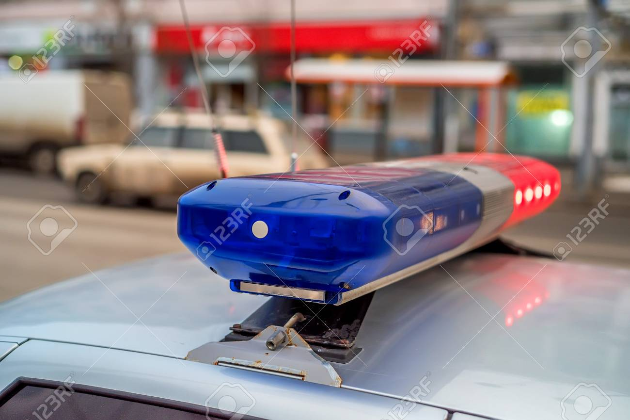 The Roof Mounted Lightbar Of Police Car