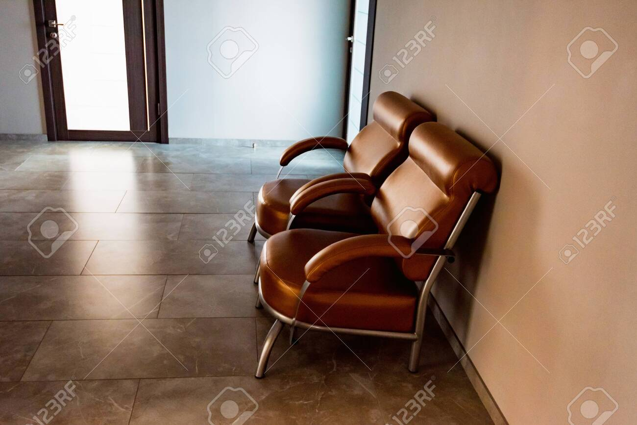 Brilliant Two Brown Leather Chairs In Hall Or Waiting Area Gmtry Best Dining Table And Chair Ideas Images Gmtryco