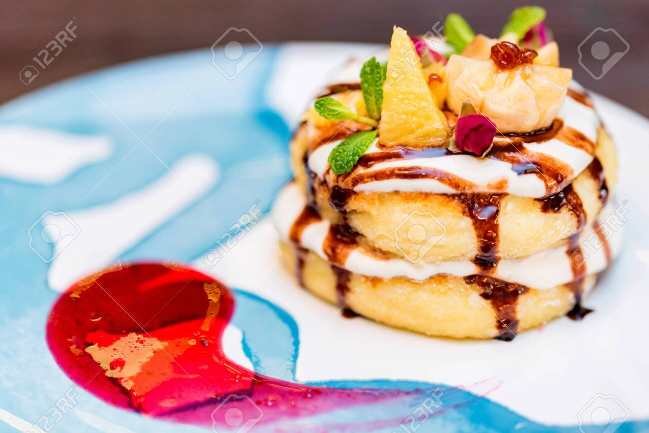 Close up dessert of cottage cheese pancakes or syrniki. Ukrainian and russian dessert . Selective focus. Festive Christmas food - 135967418