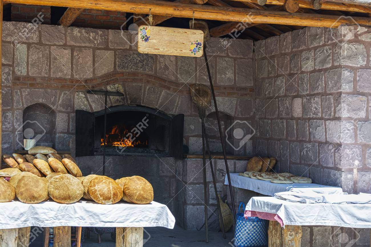 Old Stone Oven And Breads Stock Photo