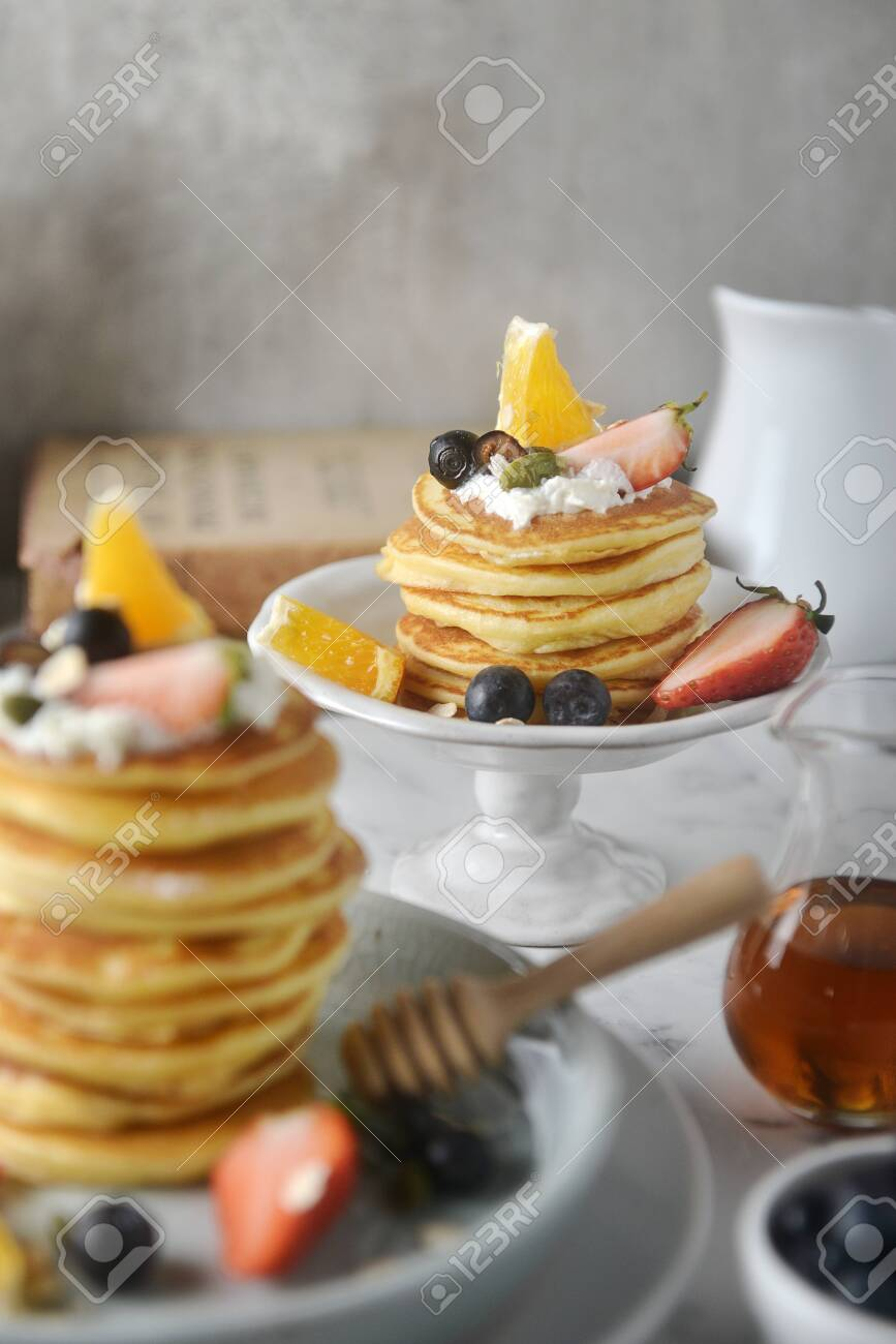 Beautiful dessert, fresh pancakes with blueberries, strawberries,