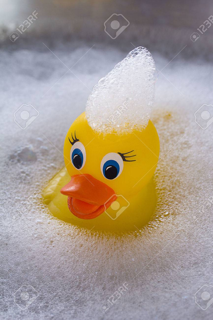 Yellow Rubber Duck Floating In Soap Suds Stock Photo, Picture And ...