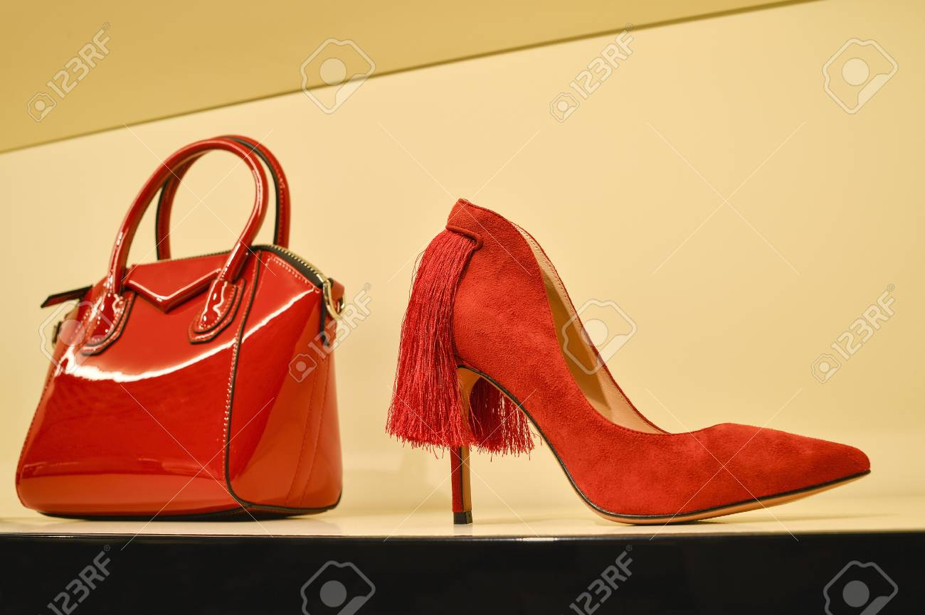 1a88cc3ed8b Red womens bag in a combination of red stilettos. The concept..