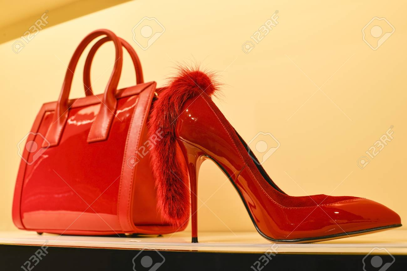 ed8f6f7ca91 Red women's bag in a combination of red stilettos. The concept..
