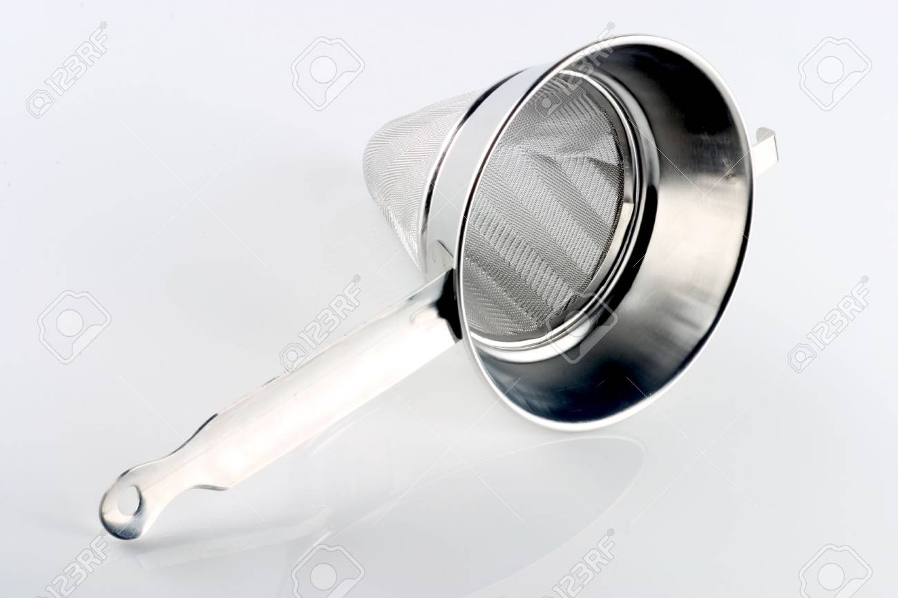A chinoise (sometimes chinois) is an extremely fine meshed conical sieve used for straining soups and sauces to produce a very smooth texture. It can also be used to dust pastries with a fine layer of powdered sugar - 121743239