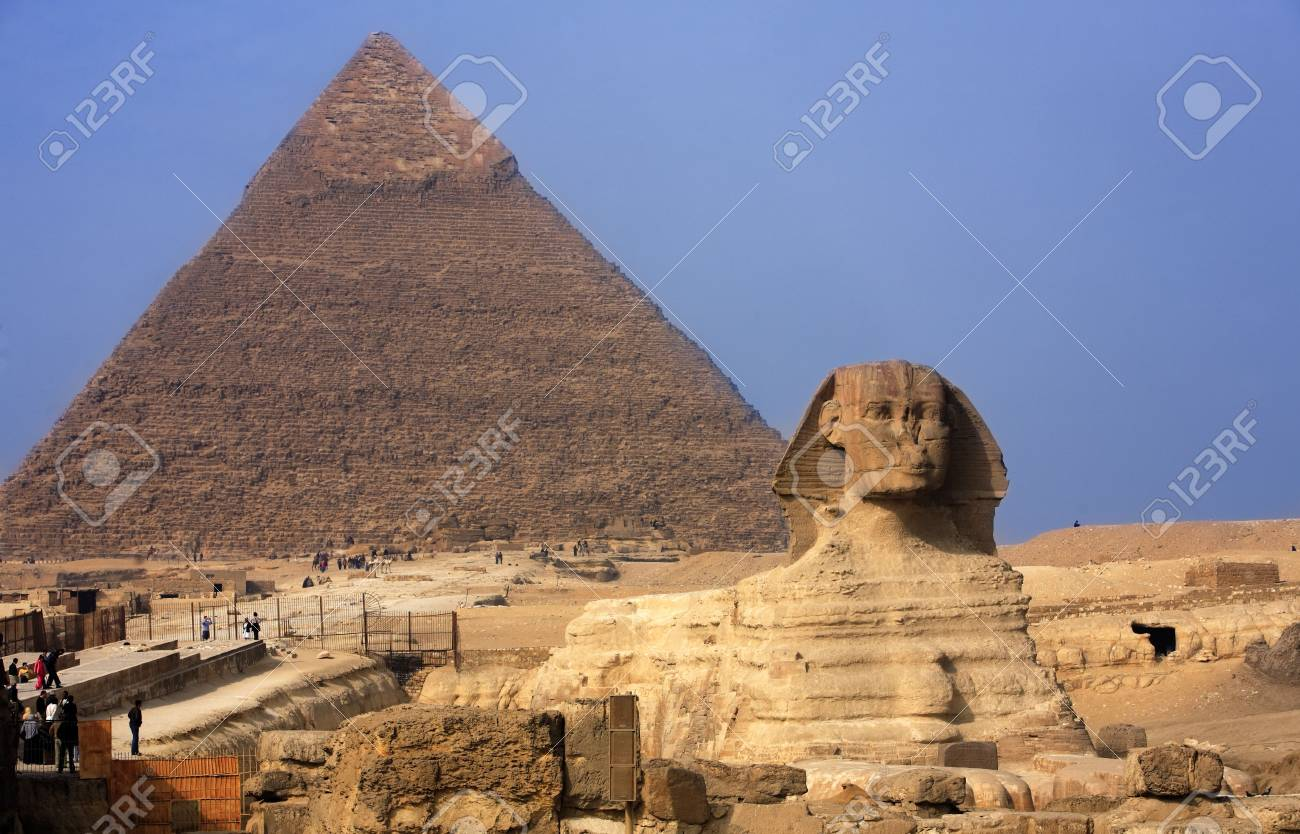 view of the sphynx with the pyramids of gizah near cairo in egypt - 121743481