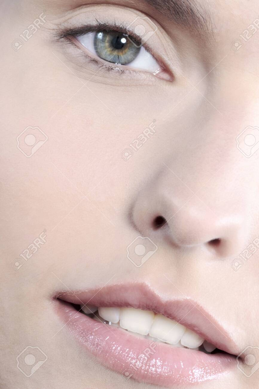 studio shot close up detail of the face of a beautyful young women with perfect lips mouth and teeth smiling - 121743518