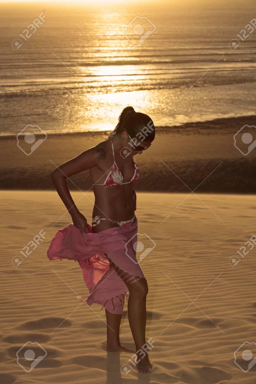 beautiful bikini dressed with a saron young brazilian woman in jericoacoara at the sunset ceara state near fortaleza - 121743626