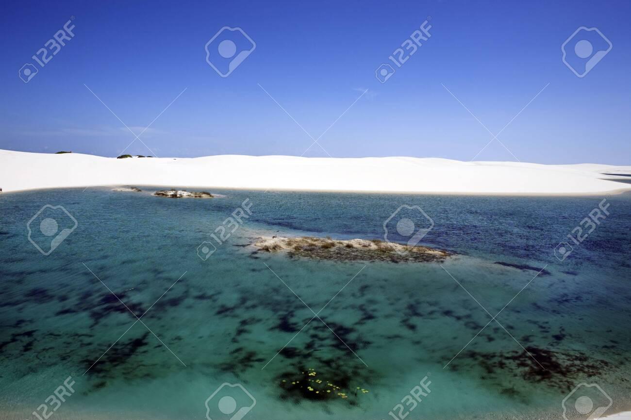 view of lagoa azul in desert sand dunes of the Lencois Maranheses National Park in brazil - 121743990