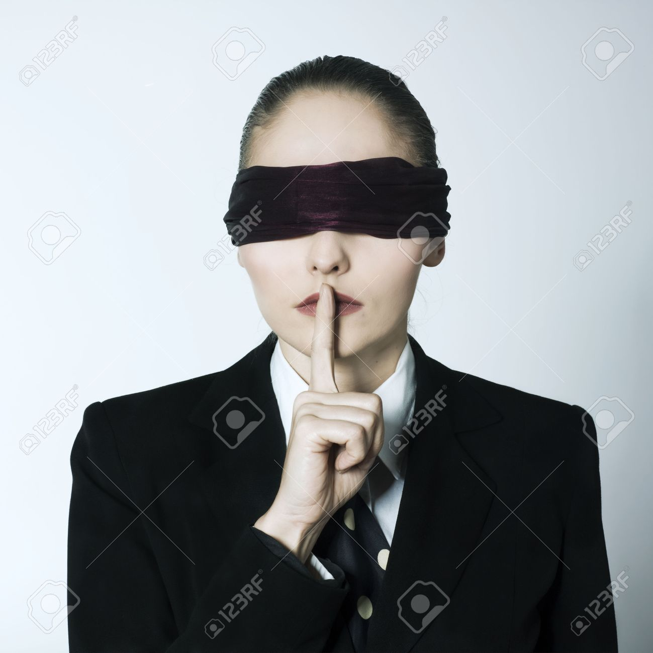 studio shot portrait of a beautiful young blindfold woman in a costume suit Stock Photo - 2966747