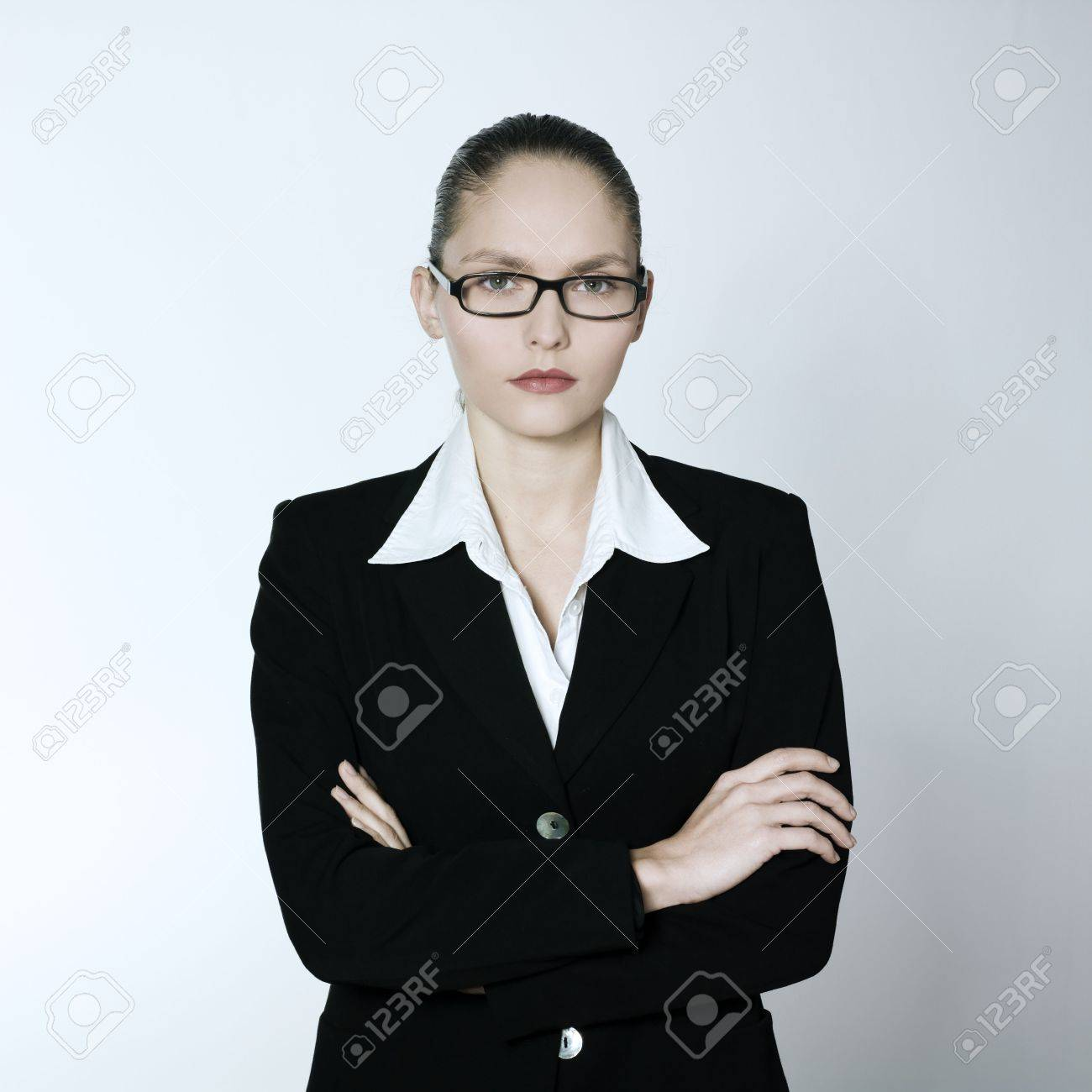 studio shot portrait of a beautiful young and strict woman in a costume suit Stock Photo - 2966649