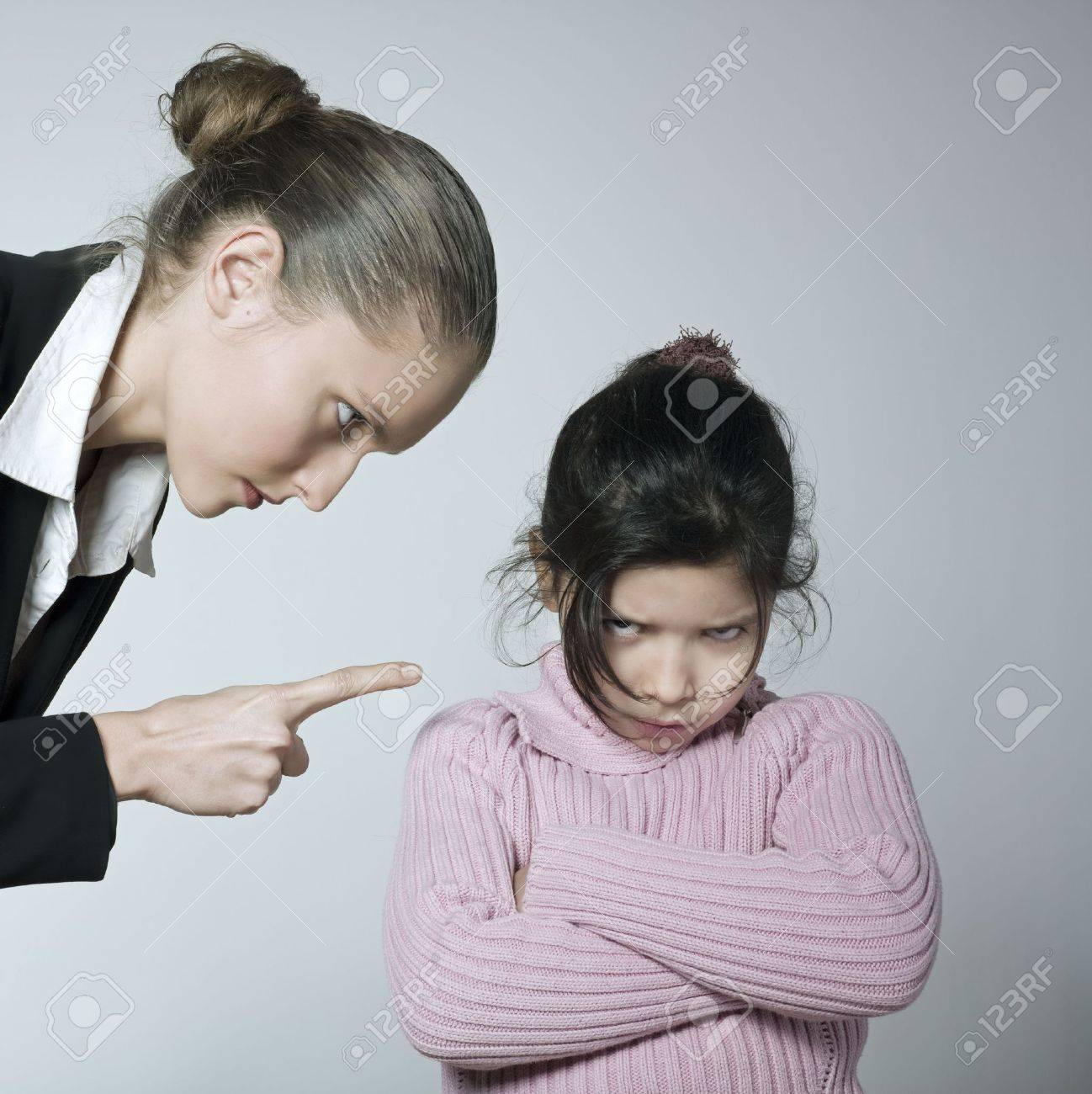 studio shot of a young woman having problem educate her child Stock Photo - 2966756