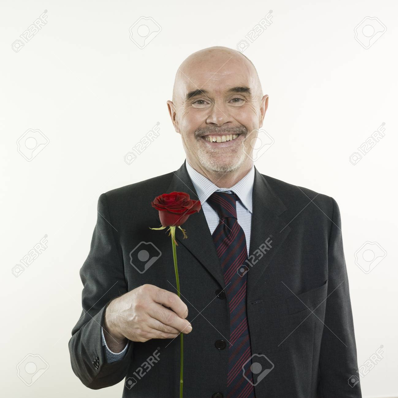 studio portrait isolated on white background of a man senior holding a rose flowe Stock Photo - 2966790