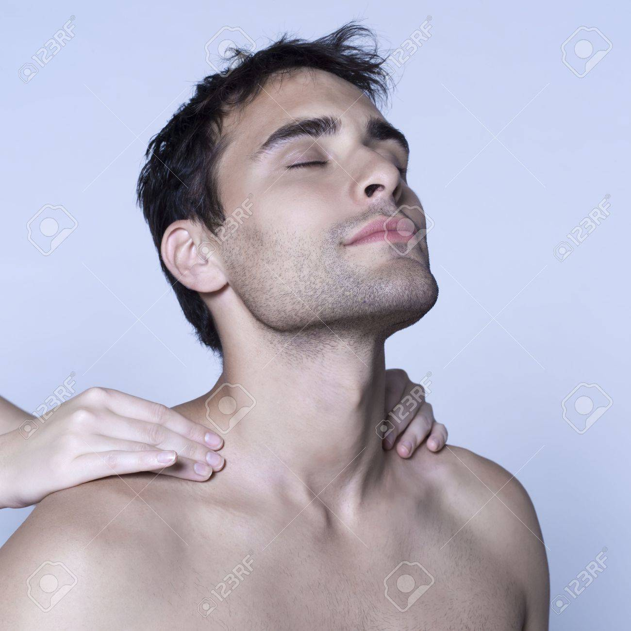 studio shot on isolated background of a handsome man having a massage Stock Photo - 3540460