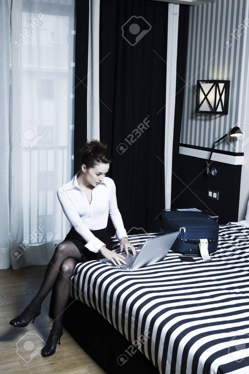 beautiful caucasian woman in a hotel bedroom Stock Photo - 3641667