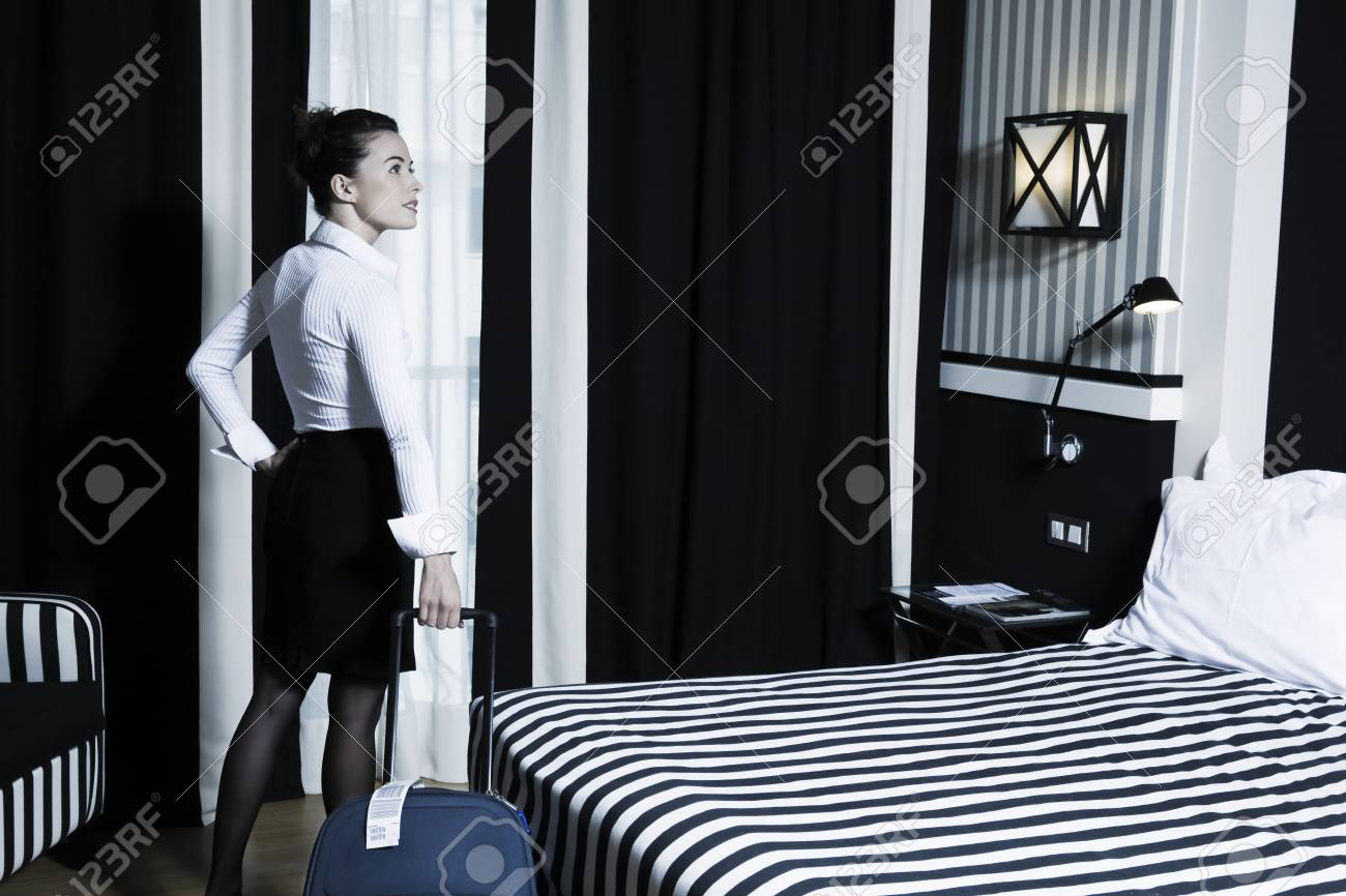 beautiful caucasian woman in a hotel bedroom Stock Photo - 3641666