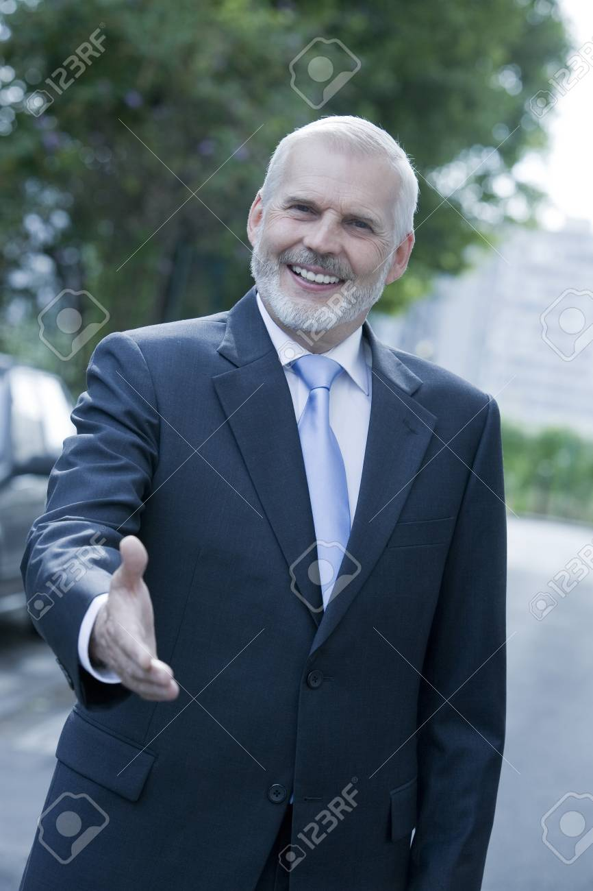 expressive portrait of a handsome senior businessman on isolated background Stock Photo - 3999823