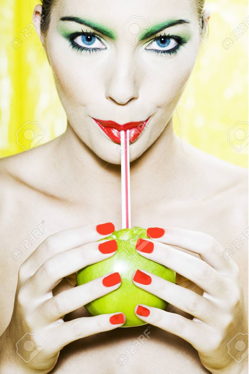 beautiful woman portrait with colorful make-up  and background drinking apple juice with straw Stock Photo - 3999549