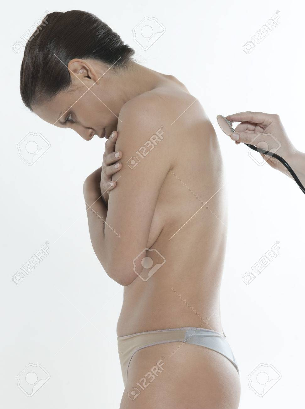 asian woman on isolated background doing medical exam Stock Photo - 5978057