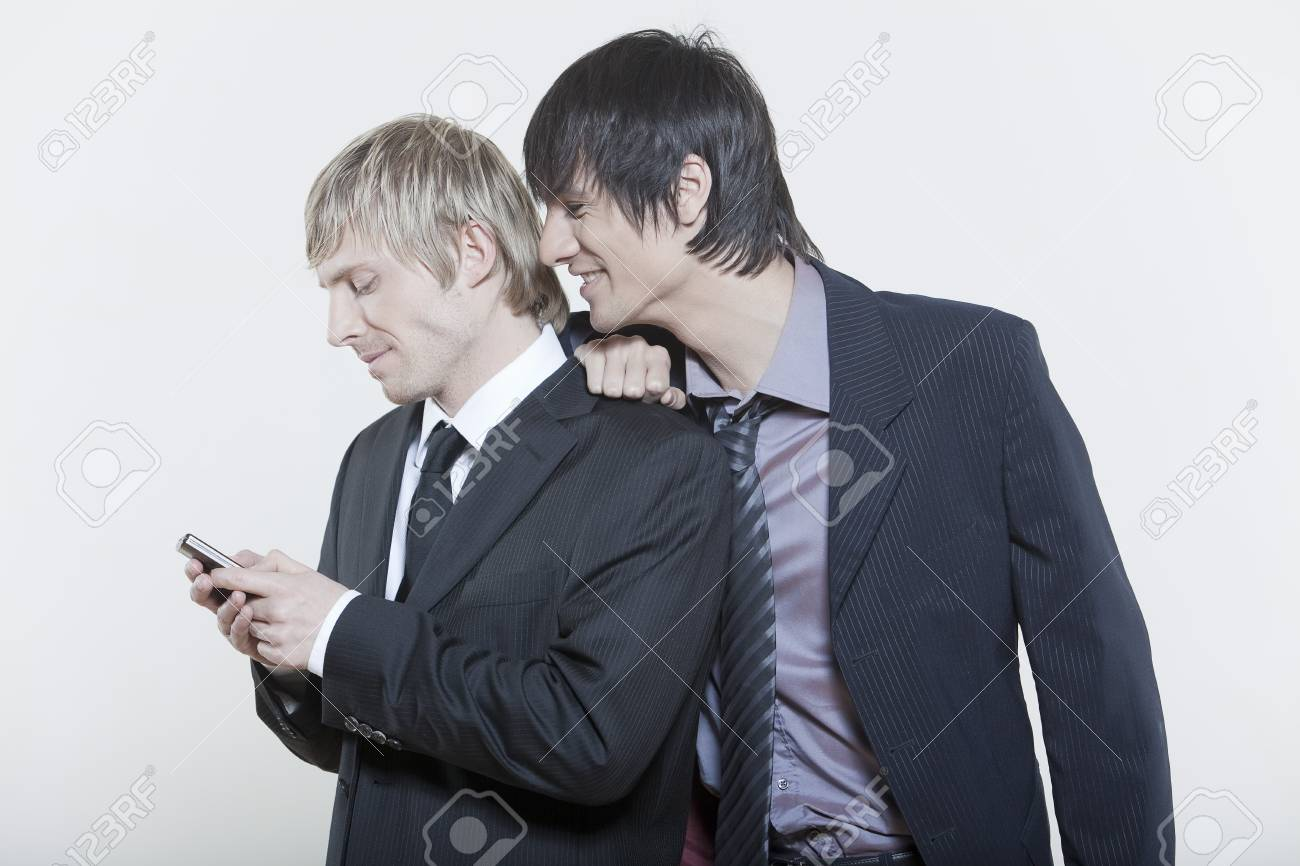 two male expressive young men on isolated background Stock Photo - 5978245