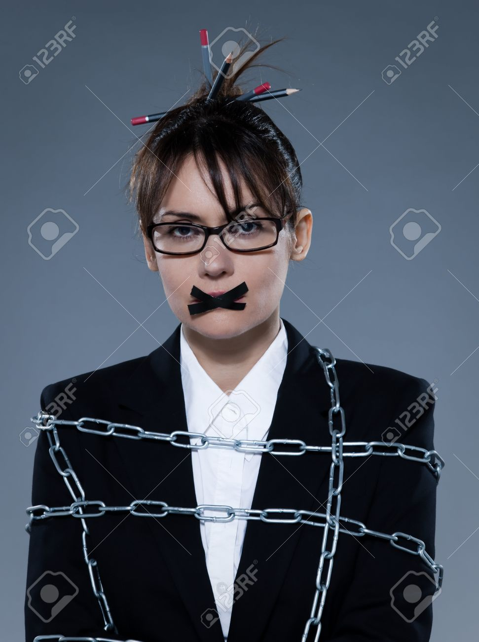 beautiful business woman chained on isolated background Stock Photo - 11644475