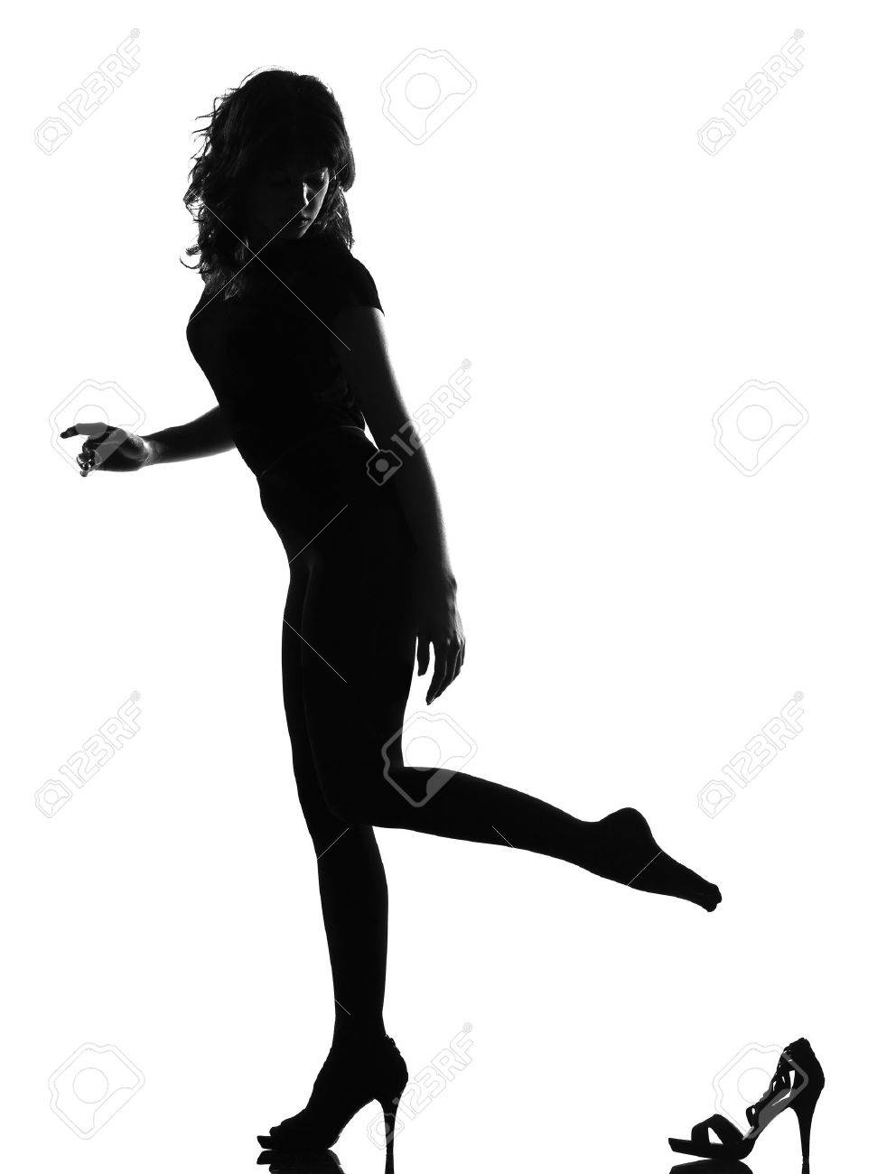 full length silhouette in shadow of a young Cinderella woman losing her shoe in studio on white background isolated Stock Photo - 9799864