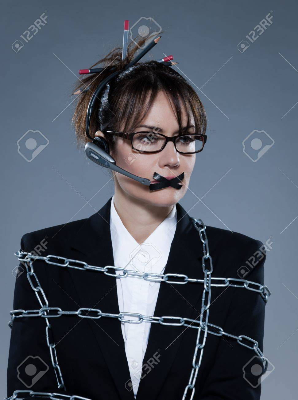 beautiful business woman chained on isolated bacground with headset Stock Photo - 9823760
