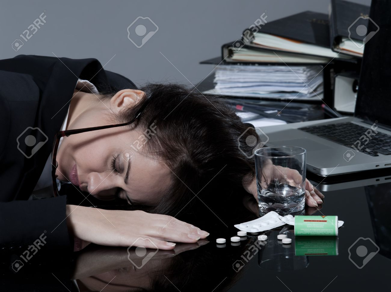 beautiful brunette business woman at her desk committes suicide Stock Photo - 9823774