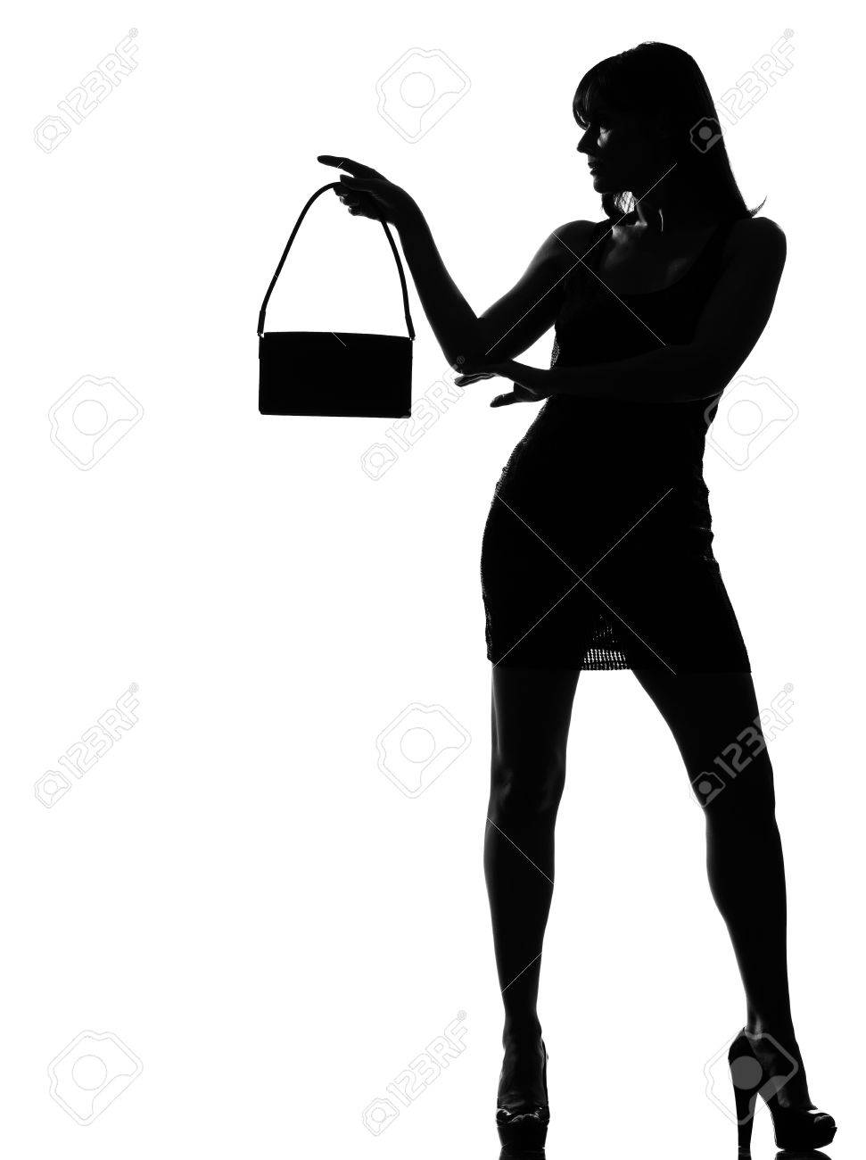 stylish silhouette caucasian beautiful woman holding purse full length on studio isolated white background Stock Photo - 9799883