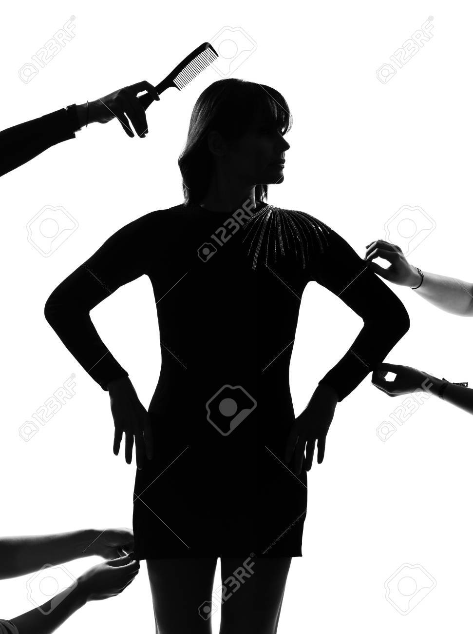 stylish sexy silhouette caucasian beautiful woman fashion model getting ready for photo session  on studio isolated white background Stock Photo - 9800059