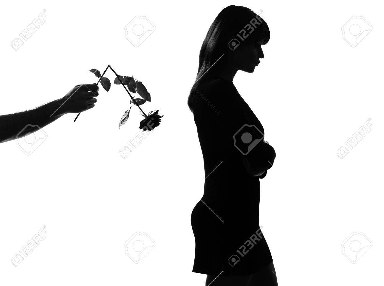 man hand offering a flower rose  stylish sexy silhouette caucasian beautiful woman on studio isolated white background Stock Photo - 9799870