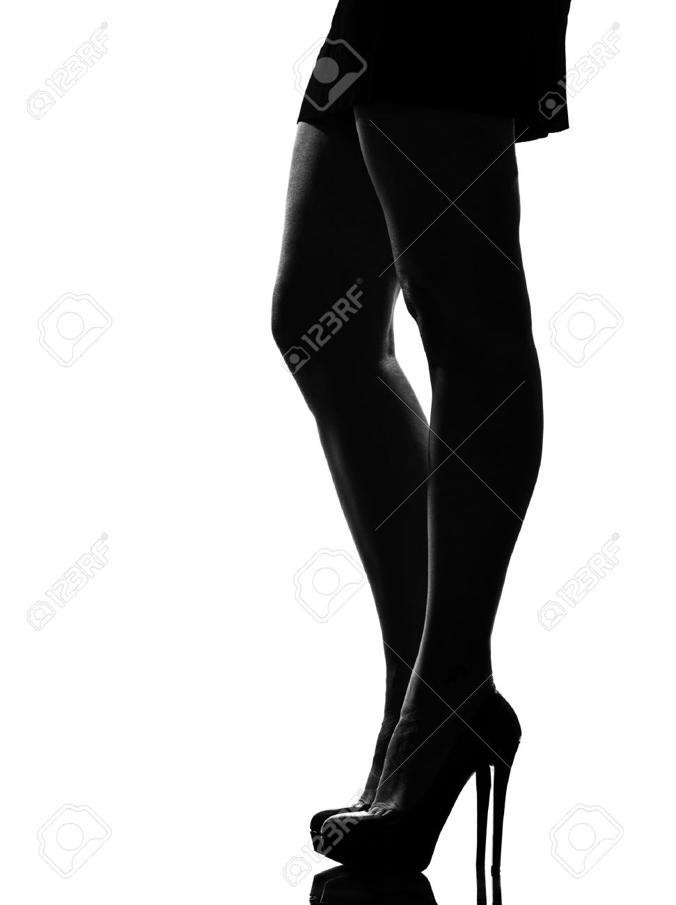 stylish silhouette caucasian beautiful woman legs shoes high heels  stileletto silhouette on studio isolated white background Stock Photo - 9799939