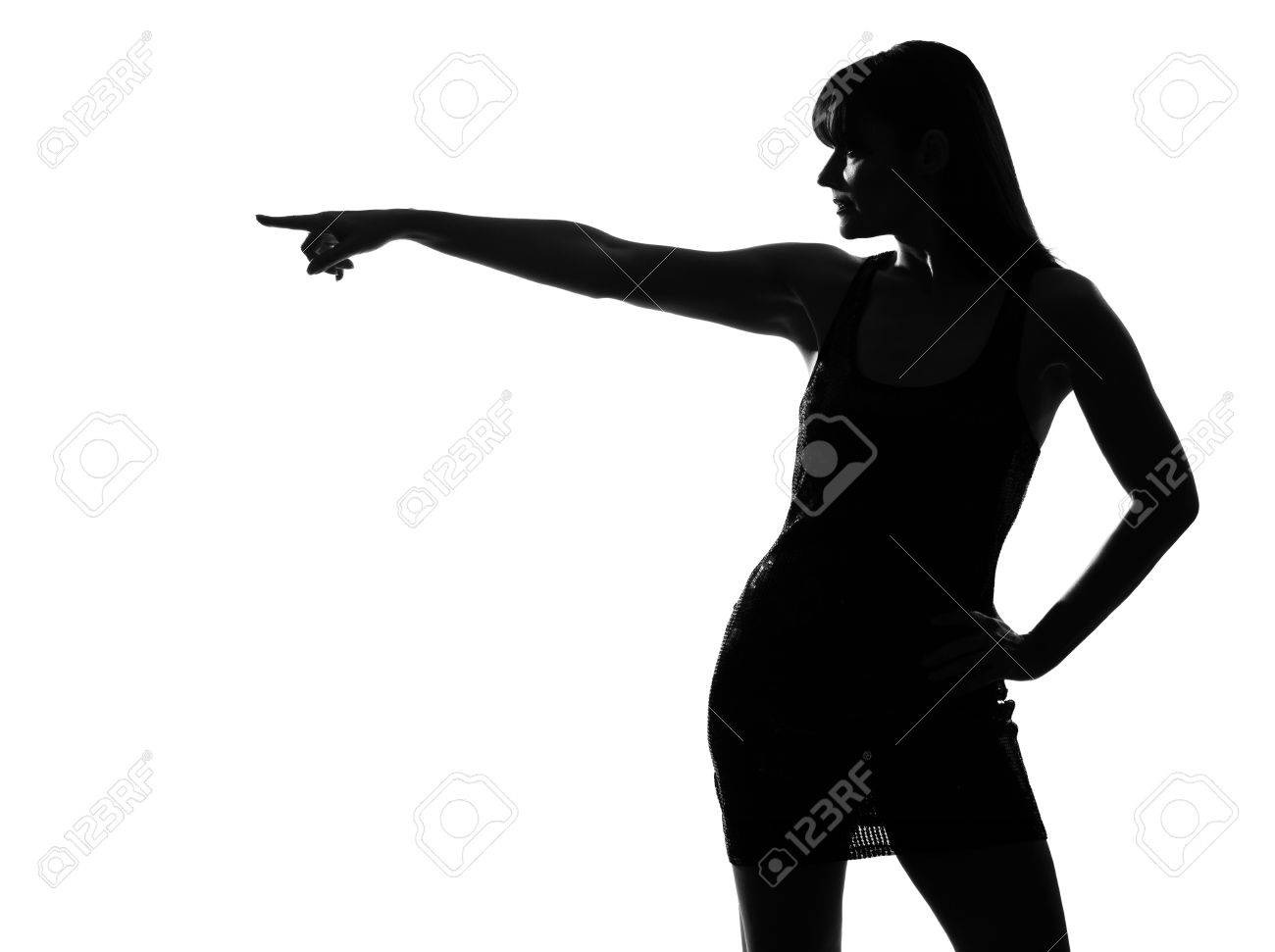 stylish sexy silhouette caucasian beautiful woman profile poiinting on studio isolated white background Stock Photo - 9799874