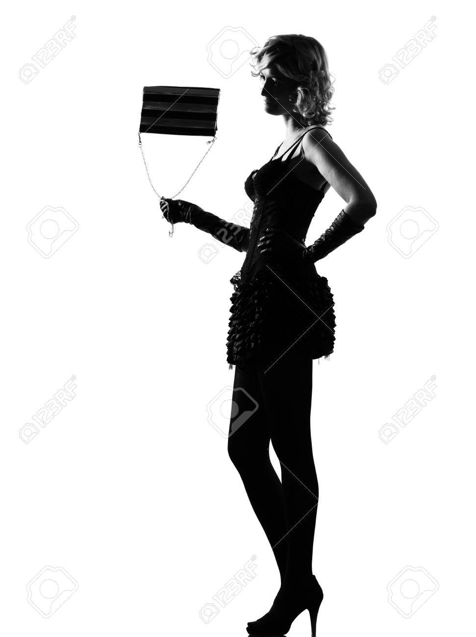 stylish silhouette caucasian beautiful with purse woman sexy  attitude behavior clothes full length on studio isolated white background Stock Photo - 9799930
