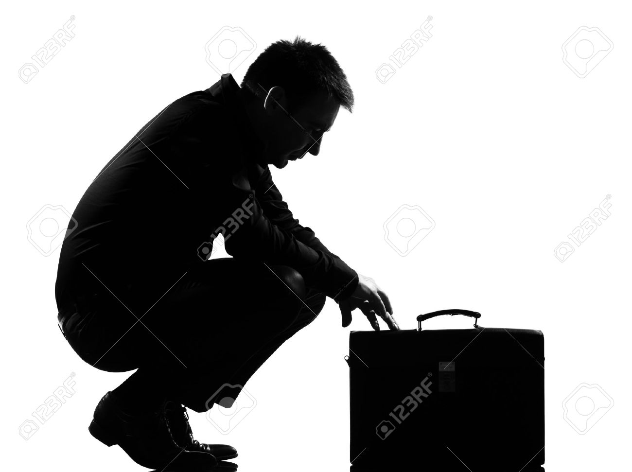 silhouette caucasian business man  expressing fatigue despair tired behavior briefcase  full length on studio isolated white background Stock Photo - 9799788