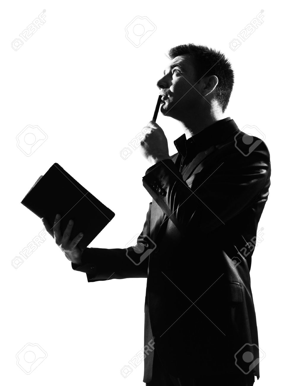 silhouette caucasian business man with note pad thinking expressing behavior full length on studio isolated white background Stock Photo - 9800096